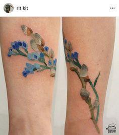 Lineless blue flower tattoo