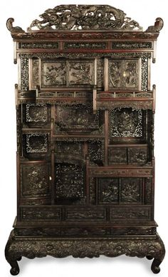 A monumental and heavily carved rosewood cabinet, Meiji Period (1868 - 1912) Japanese. Extensive carved design and impressive detail throughout. Measures 103 X 62 X 24 deep. LOT 248