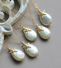 Items similar to Bridesmaid GIFT SET of FIVE Starfish Necklaces, 14k gold fill with Ivory Freshwater Teardrop Pearls, Beach Wedding Jewelry on Etsy