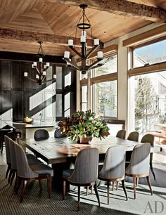 Rustic Dining Room by Stephen Sills Assoc. and Menendez Architects in Aspen, Colorado