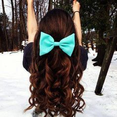 Dark red/brown hair color w/ contrasting aqua bow...love how the curls look too
