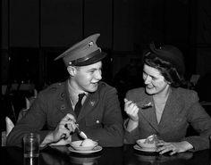 A soldier & his girl sitting at soda fountain counter eating ice cream. Connecticut,1942.