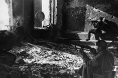 """Stalingrad in October of 1942, Soviet soldiers fighting in the ruins of the factory """"Red October""""."""