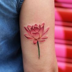 Gorgeous lotus flower tattoo by Joice Wang