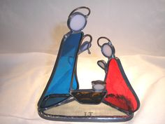 LT Stained glass Christmas Nativity ornament freestanding blue and red clear glass on base. $25.00, via Etsy.