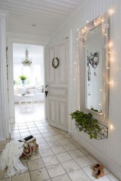 Scandinavian. Dreamy. Love the indoor window box and lighted mirror