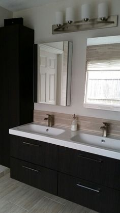 My bathroom remodel: modern and practical. Pfister Venturi faucet, Ikea Godmorgon cabinets, and Kohler Verdera Mirror cabs.