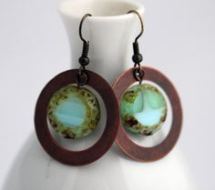 A Beautiful Czech Picasso Ocean Disc Bead framed with Antique Copper Circles dangle on simple antique bronze ear wires