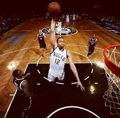 Jabari Parker soaring for the dunk.