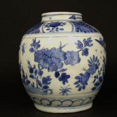A Transitional Porcelain Blue and White Jar, Late Ming, Chongzhen Period 1628-1644. Decorated with Flowers in a Landscape with a Bird