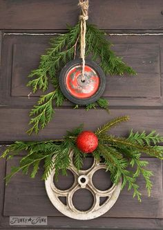 Red wagon wheel and wash-line wheel for junk wreaths /  Junk wheel Christmas wreaths via www.funkyjunkinte... #easyholidayideas
