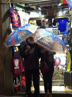 it started to rain in Barcelona, so we had to buy matching Gaudi umbrellas