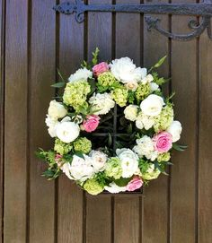 Floral wreath of roses, peonies, hydrangea.  In bloom, ltd.