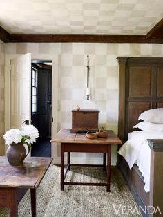 Hand-sanded checkerboard wall treatment, Jill Biskin. Sconce, Rose Tarlow Melrose House. Bed linens, Susan Shepherd Interiors. Rug, Designer Carpets. ~ Veranda