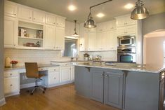 """Updated kitchen with Benjamin Moore's BM """"Cloud White"""" cabinets and BM """"Tweed Suit"""" island, lacquered by Paper Moon Painting, San Antonio cabinet painting and refinishing"""