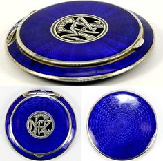 Austrian, and what an elegant sterling silver and guilloche-worked compact it is, with the brilliant cobalt blue enamel
