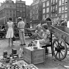 1961. A view of the Waterlooplein flea market in Amsterdam seen towards the entrance of the Zwanenburgwalstraat. Waterlooplein is a square in the center of Amsterdam, near the Amstel. The square was created in 1882 when the Leprozengracht and Houtgracht canals were filled in. In 1893 the square became a daily marketplace. The market currently has some 300 stalls and is open every day except Sunday. Photo Stadsarchief Amsterdam / Henk Daniëls. #amsterdam #1961 #Waterlooplein…