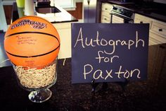 Guests autograph basketball for a display in the baby's room. Add Patchi's Soccer Champ chocolate favor to this table for a special treat at a baby shower! Sports Theme Birthday, Basketball Birthday Parties, 10th Birthday Parties, Boy Birthday, Birthday Ideas, Basketball Party Favors, Birthday Basket, Kid Parties, 12th Birthday