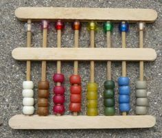 How to make an abacus using craft sticks and beads