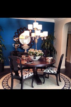 Nice small bold dining room with round table.
