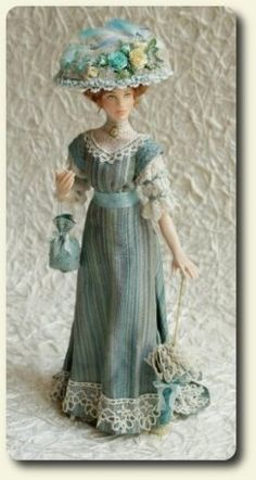 Hand painted 1900s porcelain miniature doll by CDHM and IGMA Artisan Elisa Fenoglio