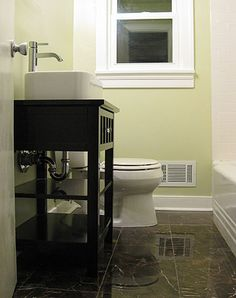 Another example of light walls, white trim and molding with dark/black vanity. I like the contrast.