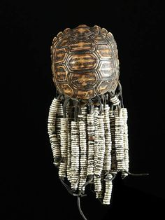 Africa | Pendant. The source did not know what tribe to attribute this to. ~ It looks very similar to the jewelry of the San in Botswana, especially given the choice of ostrich egg shell beads rather than glass beads. | ca. 1950s. BelAfrique - your personal travel planner - www.BelAfrique.com