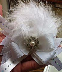 white boutique bow with maribou xx