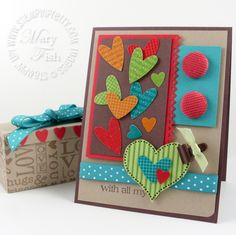 Heat embossing added delicious shine and texture to my hearts and gift box.  Think patent leather!  VersaMark and Clear Embossing Powder give a cool tone on tone effect.  I embossed using the Solid Stripes stamp for the largest heart before I layered the dotted heart stamp on top.