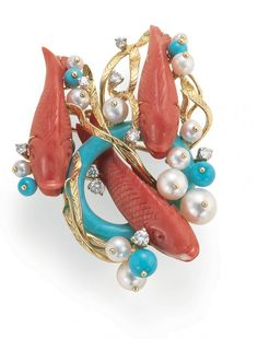 A Koi Fish Brooch in Coral, Turquoise, and Pearl set in 18K Yellow Gold.  Signed Seaman Schepps.
