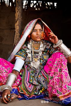 Portrait of a Marwada Meghwal Harijan woman wearing traditional clothing and a large golden wedding ring through her nose, Hodka, located roughly from Bhuj in the Kutch District, Gujarat, India