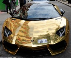 World's most expensive car? gold Lamborghini seen in Paris Labelled as quite possibly the most expensive car in the world, the gold Lamborghini Aventador has been spotted cruising the streets of the French capital Lamborghini Aventador Price, Gold Lamborghini, Ferrari, Maserati, Bugatti, Sexy Cars, Hot Cars, Royce, Jaguar