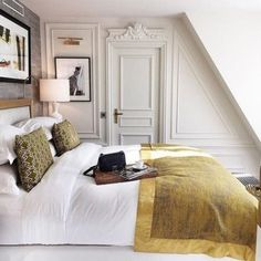 a small attic Parisian bedroom with artworks, a comfy bed, lamps and stucco for decorating the walls Blue Bedroom, Trendy Bedroom, Bedroom Colors, Modern Bedroom, Bedroom Bed, Design Bedroom, Bedroom Ideas, Home Decor Styles, Cheap Home Decor