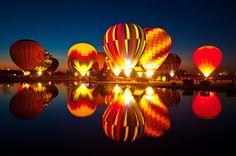 Hot air balloons, reflections, and dusk.
