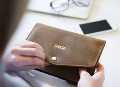 Keep your money, cards and even your phone safely tucked away in this chic leather folding purse. You can also personalise this unique purse for women to make this the best Valentine's Day gifts for her