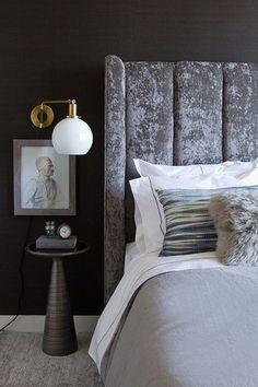 Bedroom with art and velvet headboard More