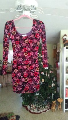 "This is my own ""nice"" dress I'll be wearing this year. A form fitting floral velvet long sleeve :*"