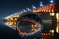 Seoul's Crystal Ball - This ball is located next to the Seongsu Bridge. The bridge was built over the Han River in Seoul, South Korea. This great structure links the Seongdong and Gangnam districts.