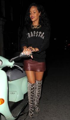 Rihanna wearing over-the-knee snake-skin boots. BEFORE Labor Day!!