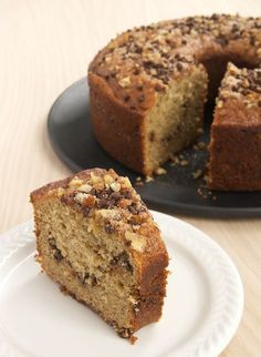 Sour Cream Banana Coffee Cake - less dense and more delicate than most coffee cakes. The banana flavor is subtle but works so well with that gorgeous ribbon of chocolate, nuts, and cinnamon.