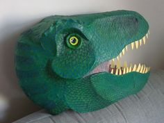 My version of the t-rex papier maché head - light and very strong. the teeth are made of funky foam.