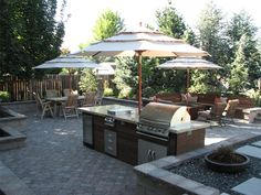 interesting use of umbrellas for the spaces - is that a firepit surrounded by the couches ? Wood, Granite, Grill, Umbrella Outdoor Kitchen Breckon Land Design Inc. Garden City, ID Outdoor Kitchen Patio, Outdoor Rooms, Outdoor Dining, Outdoor Gardens, Outdoor Kitchens, Outdoor Decor, Outdoor Ideas, Patio Ideas, Backyard Ideas
