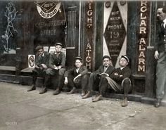 """November 1910. Birmingham, Alabama. """"A.D.T. boys (telegraph messengers). 'They all smokes.' """" Photograph by Lewis Wickes Hine, colorized."""