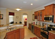 8435 Lyons Ranches Rd., Boynton Beach, FL 33472 - this 4 bedroom 3 bath home is 3-car garage home with 2,417 AC SQ FT. Chef's kitchen with all stainless appliances, wine bar,extended granite counter top, under cabinet lighting,tiled back splash, snack bar, high hat lighting, and family dining area. OFFERED BY: RE/MAX Advantage Plus/Boynton Beach