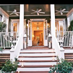 Southern Charm. that's a front porch made for whiling away the lazy summer evenings here in the south : )