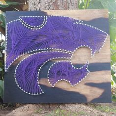 **MADE TO ORDER** Calling all Kansas State fans! Show your support with this one of a kind, made to order wall string art. Perfect for graduations, house warming parties, office decor, birthdays, dorm room decor, and more! If you need your order sooner, or would like to change anything about it, please send me a message and we can work out the details. ESTIMATED TURNAROUND TIME: 9 DAYS What am I getting? *18 tall x 20 wide x 3/4 thick board or *20 tall x 20 wide x 3/4 thick boa...