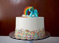 My Little Pony Birthday Cake! Featuring an edible Rainbow Dash! #mylittlepony #mylittleponycake #baking #fondant #rainbowdash #sprinkles #cake #rainbow #colorful #colors #kidsbirthday #playful #chencakes