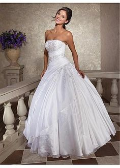 oh such a beautiful and elegant dress for a  wedding and the diamonds are perfect accent to the dress :-)