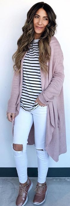#spring #outfits woman in pink cardigan and distress white fitted pants. Pic by @aroundtownbabe