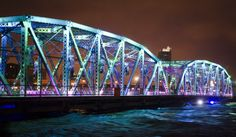 The Langevin Bridge is photographed on Friday, June with high levels of water flowing the Bow River Photograph by: Tijana Martin, Calgary Herald Dramatic Photos, Over The Bridge, Beautiful Disaster, Alberta Canada, Sydney Harbour Bridge, Natural Disasters, Calgary, Around The Worlds, The Incredibles